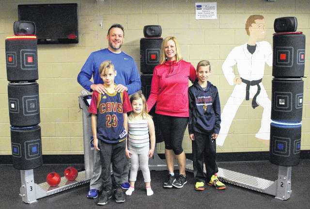 Dr. Sarah Thompson and her family are pictured with a 3Kick, which was purchased with money donated to the Fayette Family YMCA by Thompson Orthodontics.