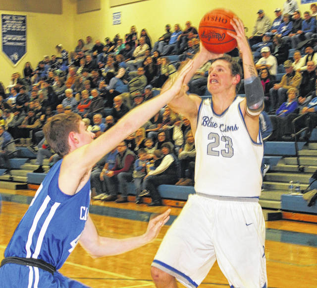 Washington Blue Lion sophomore Trevor Rarick, right, puts up a shot against Chillicothe during a Frontier Athletic Conference game Friday, Jan. 19, 2018 at Washington High School.