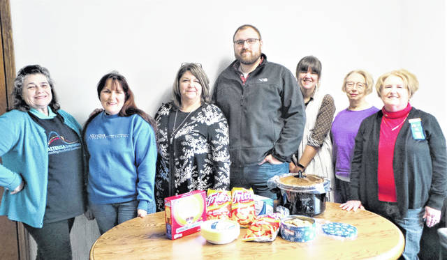"""A large crockpot full of hot chili con carne on a cold winter day. Altrusa's Communications Committee decided there could be no more suitable recipient for the committee's """"Random Act of Kindness"""" than the Record-Herald, which helps inform the community of this Washington C.H. service organization's many local projects. Debra Corbell-Grover, chair of the committee, prepared the main attraction for the newspaper employees' Friday lunch. Shown (from left): Altrusans Alice Craig, Debra Grover and Katie Bottorff, who is also general manager of the Record-Herald; then Record-Herald staff Adam Hoover and Colleen McCord; and Altrusans Nancy Hammond and President Cathy White."""
