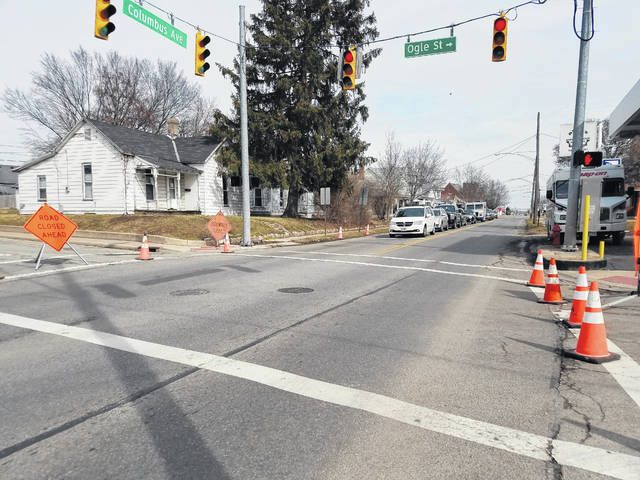 Miller Pipeline crews had a portion of Columbus Avenue closed near Ogle Street in Washington Court House Tuesday working on the sidewalk. Traffic was forced to one lane throughout the area and flaggers were in place to help control the flow of traffic.