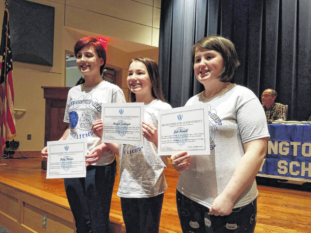 "Jack Hussell, Morgan Cartwright and Bailey Rhoades, three Washington Middle School artists, were also honored for their work on the ""Restore the Roar"" campaign T-shirts."