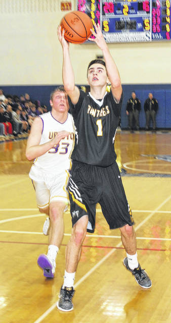 Miami Trace senior Cameron Carter drives to the basket past Unioto senior Gabe Fisher during a Division II Sectional championship game Saturday, Feb. 24, 2018 at Southeastern High School. carter was the game's leading scorer with 27 points.