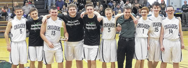The Crusaders on the court at Fayette Christian School after winning the 1st Annual Winter Basketball Invitational. (l-r); Michael Miller, Nicholas Epifano, Noah Gibbs, Aaron Turner, Lane Hufford, Spencer Hanusik, Head Coach Sal Marone, Christopher Tooill, Tyler Havens and Noah Fuller.