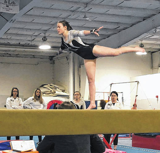 Miami Trace's Debbie Abare executes a scale to toe on balance beam.