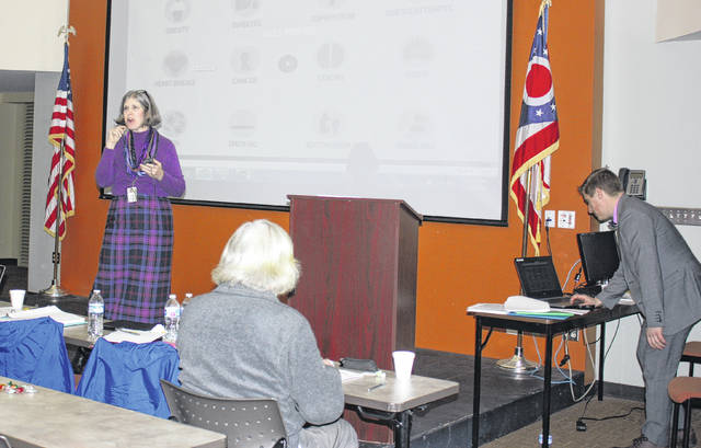 Dr. Angela Everson Ray also spoke at the event, which attracted a capacity crowd.