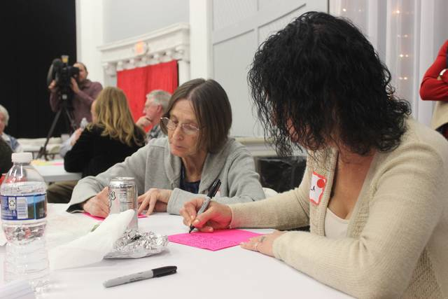 Carla Doctor (right) attended the Your Voice Ohio community forum on opioid addiction Feb. 19 and contributed her story and notes to the project. Doctor said she used heroin daily for 10 years and needed a prison conviction to initiate her recovery efforts. Doctor said she has been in successful recovery for one year and two months. Doctor's mother, Cathy (left) attended the meeting in support of her daughter. The two were featured this week on an ABC 6 television segment, 'Fayette County community uniting to fight opioid epidemic,' filmed by WSYX-Columbus and Eye on Ohio during the forum.