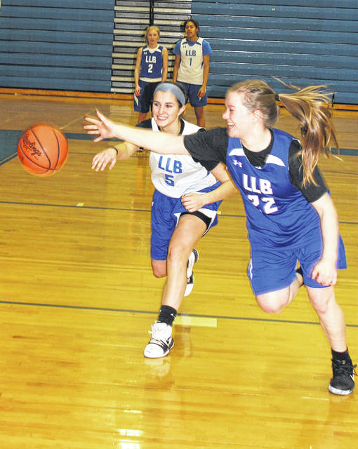 Washington's Kassidy Hines (left) and Halli Wall go for the ball during a rebounding drill at practice Monday, Feb. 26, 2018, preparing for Wednesday's District championship game against Sheridan.