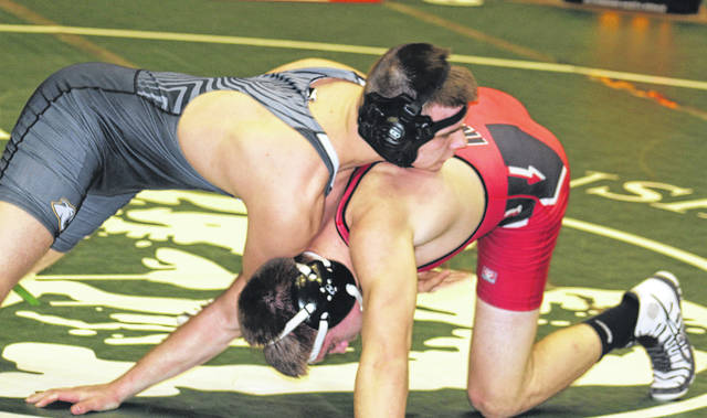 Miami Trace senior Jacob Tinkler, at left, contends with Wyatt Lane of Wauseon during the State dual team tournament Sunday, Feb. 11, 2018 at St. John Arena in Columbus. Tinkler won this match, 8-1.