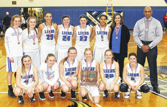 WASHINGTON LADY BLUE LIONS, 2018 DISTRICT RUNNERS-UP — The team on the court at Southeastern High School with their District runner-up trophy after a 57-44 loss to Sheridan Wednesday, Feb. 28, 2018. (front, l-r); Bre Taylor, Abby Tackage, Halli Wall, Maddy Garrison, Tabby Woods, Kassidy Hines; (back, l-r); Cloe Copas, Mallory Hicks, Hannah Haithcock, Maddy Jenkins, Shawna Conger, Rayana Burns, head coach Samantha Leach and assistant coach Mychal Turner. Not pictured, coach Corey Dye.