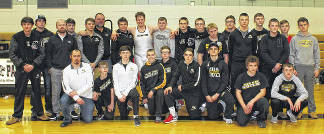 The Miami Trace Panthers in the Panther Pit after winning the first-ever Frontier Athletic Conference wrestling championship Saturday, Feb. 10, 2018. It was also the final-ever wrestling tournament to be held in the storied, old venue. (front, l-r); head coach Ben Fondale, Titus Lehr, Storm Duffy, Graham Carson, Shane Seymour, Mcale Callahan, Jaymon Flaugher, Alex Boldman, Zach Tinkler; (back, l-r); Wes Gandee, Coby Hughes, coach Jacob Garringer, coach Jeff Litteral, Dylan Murphy, coach Jack Anders, Dalton Bartley, Grant DeBruin, B.J. Anders, James Munro, Dylan Arnold, David Tyndall, Luke Henry, Jacob Tinkler, Ashton Curtis, Luke Anders, Alex Smith and Dawson Wallace.