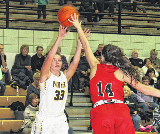Miami Trace senior Morgan Miller puts up a shot over the fingertips of Fairfield Union's Ava Moellendick during the final-ever basketball game to be played in the Panther Pit Thursday, Feb. 8, 2018.