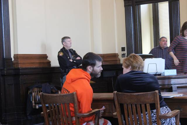 Toby Thompson, from Mt. Sterling, conferred with his attorney, Kathryn Hapner, during a hearing Monday in which he admitted to smoking an illicit substance. The man reported that the substance he smoked was crack; a bag in the vehicle was found to have a small amount of heroin.