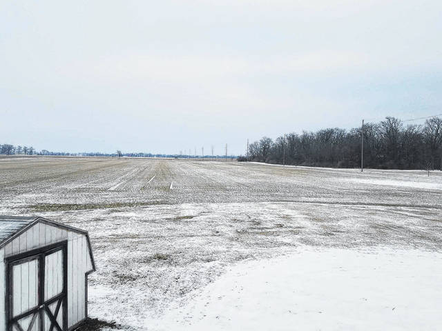 Snow covered the county Wednesday following another winter storm, including in this field off State Route 41 near Miami Trace High School.