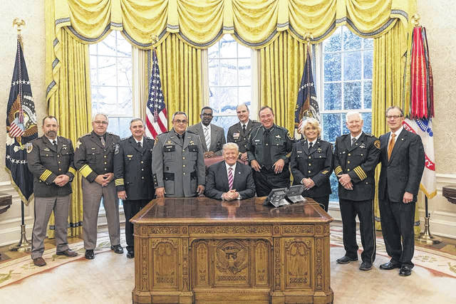 Fayette County Sheriff Vernon Stanforth, along with eight other sheriffs, were invited to the White House recently to discuss law enforcement issues impacting local communities. The discussions included topics such as the opioid epidemic, human trafficking, asset forfeiture, mental health and other relevant topics. Stanforth and other members of the National Sheriff's Association joined President Donald Trump in the Oval Office. Stanforth is pictured standing directly to the left of President Trump (seated).