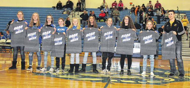 The Washington Middle School seventh grade girls basketball team was recognized at halftime of the Blue Lion boys game against Springfield Shawnee Saturday, Feb. 17, 2018. The team won the Frontier Athletic Conference tournament, defeating Greenfield, 17-16 and then beating Miami Trace, 29-26. The young Lady Lions finished with a record of 13-2. (l-r); Kendall Dye, Addi Chambers, Kayli Merritt, Kaelin Pfeifer, Natalie Woods, Madison Haithcock, Megan Sever, Abby Wilson, Allison Mongold and head coach Nancy Coulter. Not pictured: Jordan McCane and Makenzie Tyler.