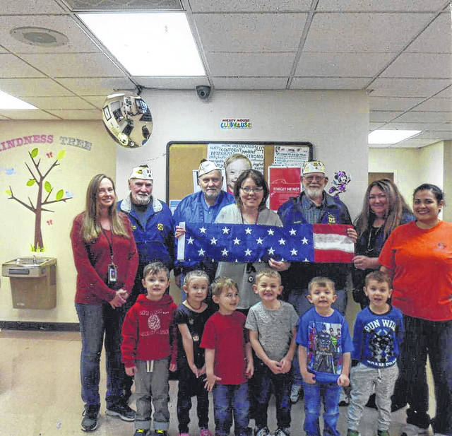 The VFW Post 3762 presented a flag to the Fayette Progressive School staff and kids.