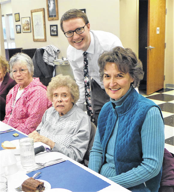 """Grace United Methodist Church's traditional """"Lenten Luncheons"""" reached their 2018 halfway point on the first day of March. More than 130 Fayette Countians—members of various local Christian denominations who had made advance reservations as well as the two dozen GUMC members who prepared and served the food—joined together in a noontime meal followed by an inspirational talk. At this third of six consecutive Thursday luncheons, the Reverend Gray Marshall from First Presbyterian Church was the dynamic featured speaker. Pictured with him prior to the start of the meal are (from left) Joy Honaker from First Baptist Church, Janet Sollars from Grace United Methodist Church, and Phyllis Matthews from Fayette Bible Church."""