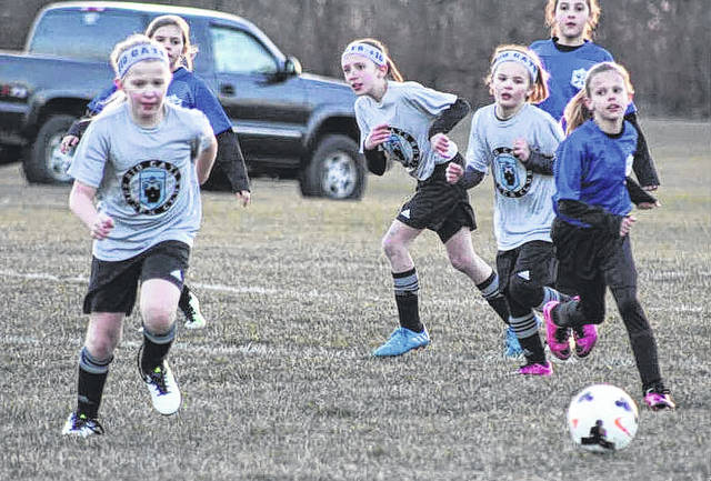 Nora Morrison, Hailey Webster, and Emma Hagler (from left to right) are pictured for the Big Cats during their game against Club X United Friday, March 23, 2018.