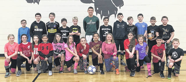 On Wednesday, March 28, 2018, Wright State University standout freshman soccer player Blake Pittser attended the Big Cat Soccer Club's soccer practices. Pittser was on hand to discuss his soccer career and what it takes to make it to the highest level of college soccer. Wright State University fields a NCAA Division I soccer team and competes in the Horizon League. (front, l-r); Nora Morrison, Lauren Farrens, Gabbi Thoroman, Calee Ellars, Kamika Bennett, Hailey Webster, Lyndyn Gibbs, Jordyn Gray, Laynie Swonger, Belle DeBruin, Emma Hagler and U9 boys Ethan Bartley and Cam Thoroman; (back, l-r); Shane Crago, Robbie Bennett, Levi Morrison, Sinjin Smith, Landon Burns, Blake Pittser of WSU, Janson Smith, Gage Merritt, Ian Mavis, Owen Teter, Logan Helfrich, and Isaiah Stuckey.
