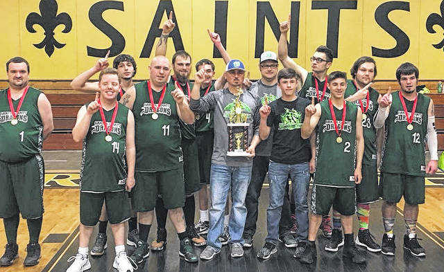 The Fayette Country Dragons celebrate after winning the Special Olympics State Division II basketball championship Saturday, March 24, 2018 in Dover, Ohio.
