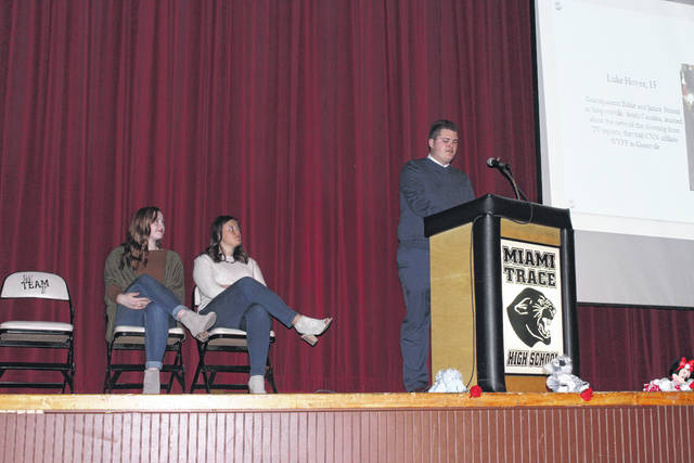 Dylan Page (at podium) was one of the speakers at Wednesday's event inside the high school auditorium.