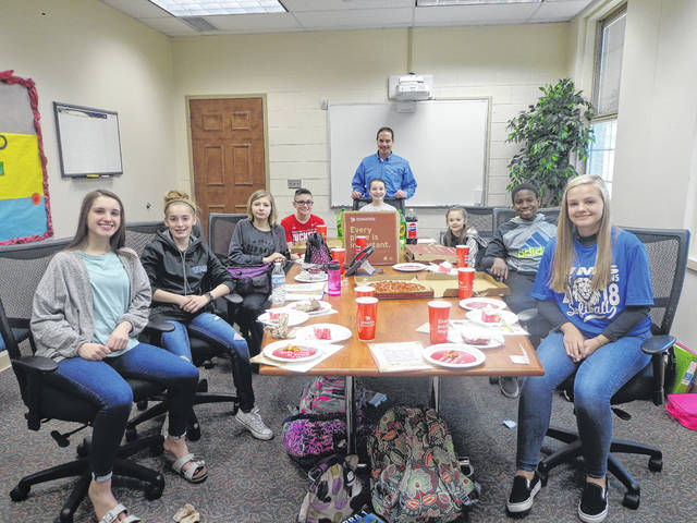 """Donatos recently provided pizza to these students at Washington Middle School as they celebrated """"Pizza with the Principals."""" This is in appreciation for their selection as Students of the Month for March. They are chosen by their teachers because of the outstanding example they set for their peers in such areas as academic effort, good work ethic, kindness to others, and service to their school. Pictured (L to R): Olivia Wayne, Chloe Lovett, Allison Clay, Jacob Michael, Morgan Cartwright, Principal Mr. Wayne, Tyrena Cowman, Gabe Tayese and Makenna Knisley. Not pictured: Gianna McManus."""