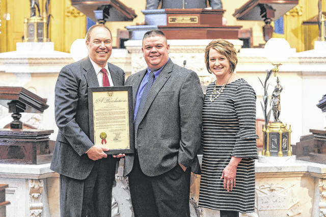 State Senator Bob Peterson (R-Washington Court House) recognized Nick and Sunny Cummings from Washington Court House for being named the 2018 National Outstanding Young Farmers. Peterson (left) is pictured with Nick and Sunny during a recent Senate session.