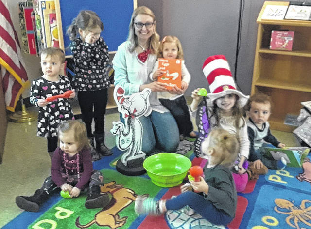 """Children celebrated Dr. Seuss's birthday by reading """"Green Eggs and Ham"""" with Miss Noel at Books and Blocks storytime."""