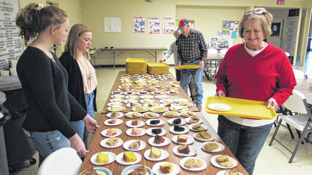 The Washington Kiwanis Club on Saturday held its annual Soup Supper at the Fayette County Senior Citizens Center. The club was assisted by Kiwanis Key Club members from Miami Trace High School. Pictured are, from left, Key Club members junior Jessica Camp, senior Jillian Sollars serving deserts to Washington CH members Glenn and Bonnie Meadows and Daisy Shiltz, at right. Key Club members Kylie Pettit and Devin Howard were also on hand to assist Kiwanis at the annual event.