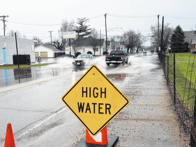 Heavy rain flooded portions of Fayette County Tuesday, forcing county crews to warn drivers of high water areas with signs around the community. Drivers were urged to remain cautious, though Fayette County Engineer Steve Luebbe said he did not believe any areas were impassable or overly dangerous for travelers.