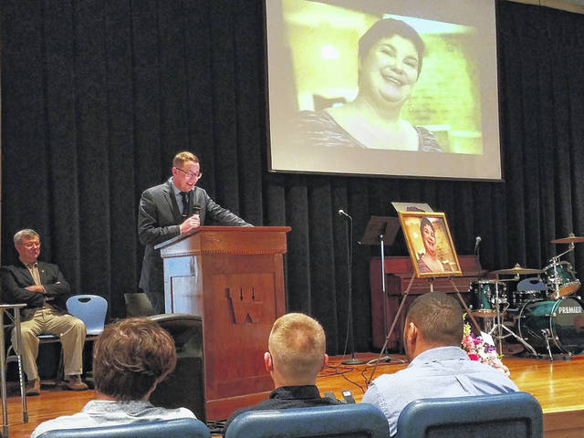 Washington High School celebrated the life and career of Laura Voorhis who passed away on Wednesday, March 28, at the Cleveland Clinic after a short battle with cancer. She was a beloved teacher with many hobbies and interests which brought together many people. Pictured is Trevor Patton reading a poem as a tribute to the late Voorhis.