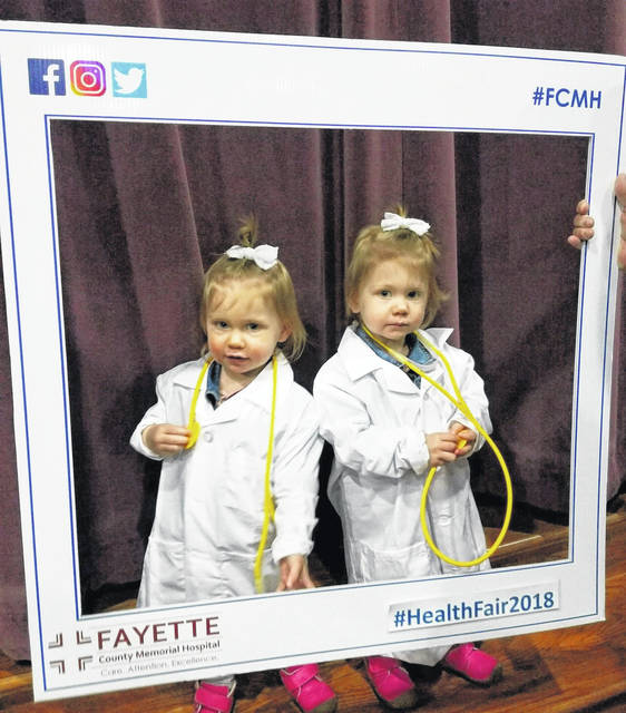 The 28th-annual Community Health Fair & Family Fun Day was held Saturday with a large crowd at Grace Community Church. The gathering took advantage of health screenings and enjoyed an entertaining day with the family. Pictured are Esselen and Elouise Tattersall posing for a photo during the Health Fair.