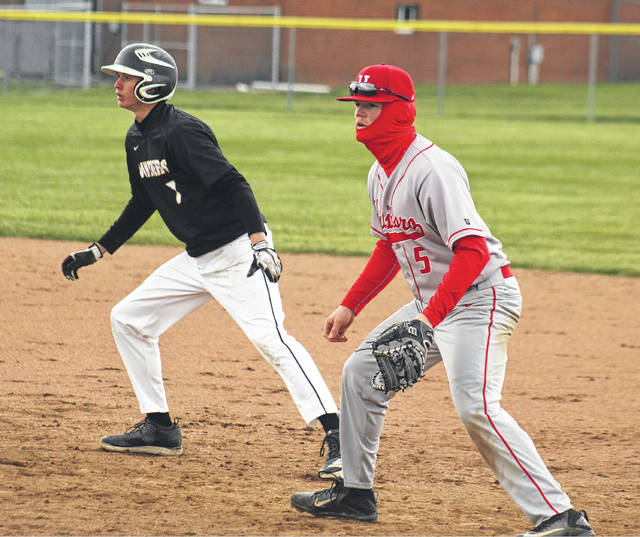 Miami Trace's Austin Brown gets a lead off first base during a Frontier Athletic Conference game against Hillsboro Monday, April 9, 2018 at Miami Trace High School. Brown was the starting and winning pitcher in the game for the Panthers.