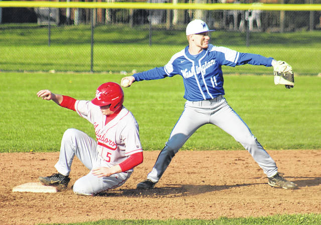 Ross Matthews sets for the throw to first after getting the force at second for the Blue Lions during their Frontier Athletic Conference game against Hillsboro, Thursday, April 19, 2018 at Washington High School.