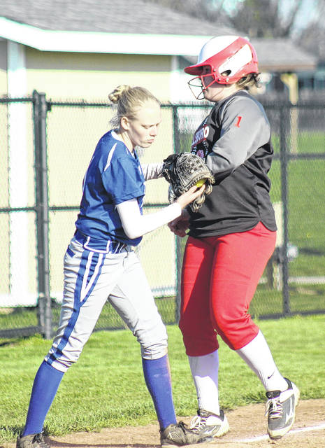 Washington's Danika Marcum (left) gets the force at third base during a Frontier Athletic Conference game against Hillsboro Thursday, April 19, 2018 at Washington High School.