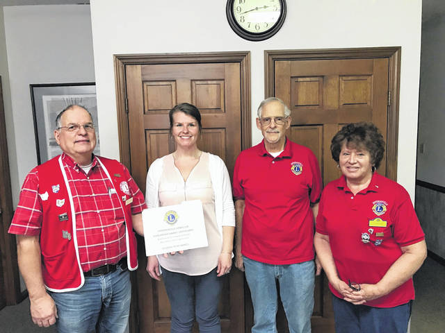 The Jeffersonville Lions Club is awarding four scholarships and assisting in a fifth to Miami Trace High School students from the Jeffersonville area. The fifth scholarship, the Ralph Detty Memorial Scholarship, is in conjunction with the Detty family. The scholarships are awarded on the basis of academic performance, extracurricular activities and need. The winners of the scholarships will be announced during graduation time. Pictured are (left to right) Lions Club member Larry Schriver, Mallory Bihl, scholarship coordinator for Miami Trace, Lions Club member Terry Jackson, and Lions Club member Sue Burnside.