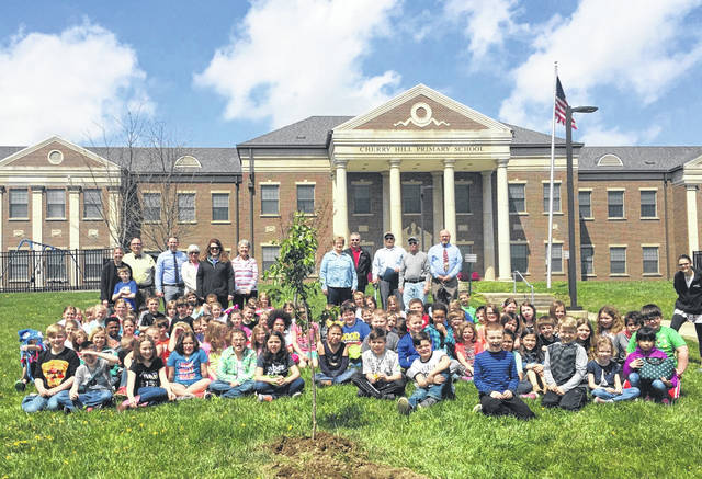 Members of the Tree Committee, Washington Court House Council, Washington Court House city administration and Cherry Hill school administration celebrated Arbor Day 2018 with the second grade class of Cherry Hill on Thursday at the school. Students helped to plant trees with the many guests during the event.