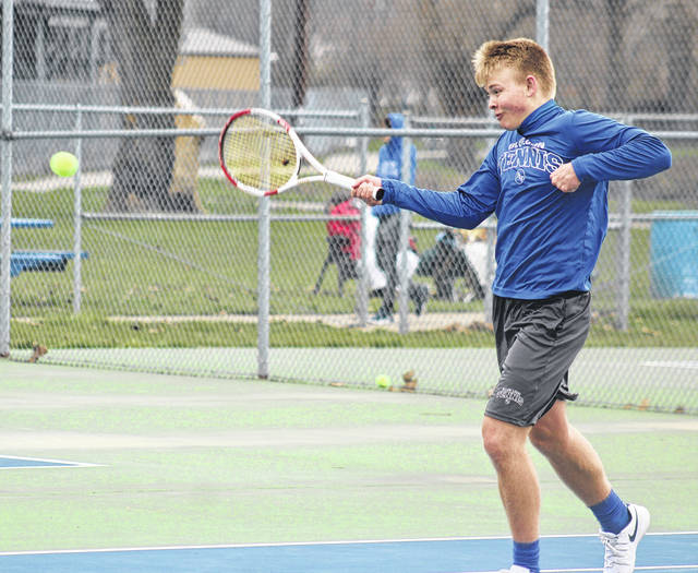 Washington's Jack Luebbe hits a return during his second singles match against Miami Trace's Eli Schirtzinger Tuesday, April 10, 2018 at Gardner Park.