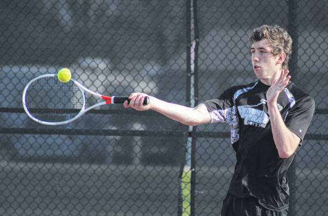 Johnathan Allen hits a return of serve for Miami Trace during his first doubles match against Jackson Friday, April 27, 2018. Along with partner Adam Ginn, the Panthers won this match, 6-2, 6-2.