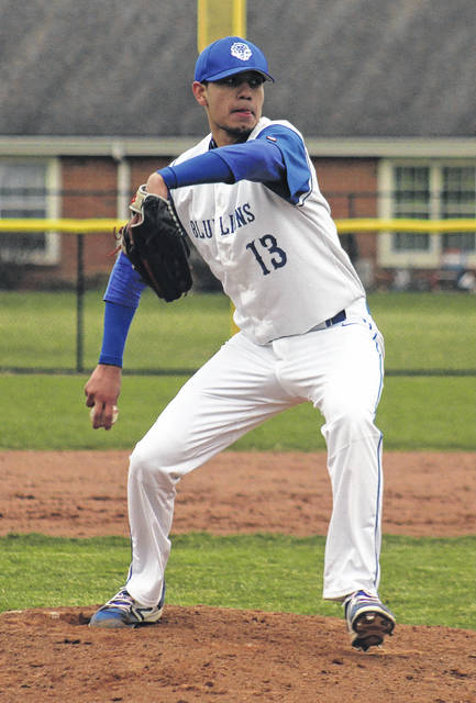 Kenny Arboleda delivers a pitch for the Blue Lions during a Frontier Athletic Conference game against Jackson Monday, April 9, 2018 at Washington High School. Arboleda pitched six innings to earn the win as Washington defeated Jackson, 6-5.