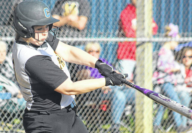 Maddie Mossbarger takes a swing at a pitch for Miami Trace during a Frontier Athletic Conference game at Hillsboro Friday, April 20, 2018.