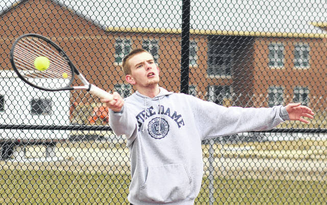 Miami Trace senior Matt Fender makes the return in his first singles match against Hillsboro on a quite cold Monday, April 9, 2018 at Miami Trace High School.