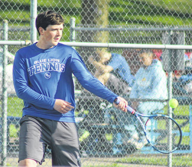Washington senior Max Schroeder hits the return of serve during a first doubles match (along with partner Maria Pickerill) during a Frontier Athletic Conference match against Jackson Wednesday, April 25, 2018 at the courts at Gardner Park.