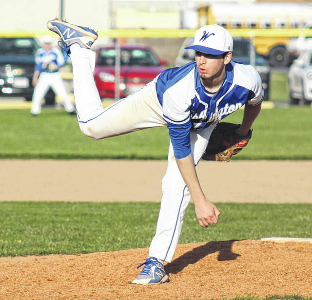 Nick Barrett delivers a pitch for the Blue Lions during their game at Miami Trace High School Friday, April 27, 2018. Barrett was the winning pitcher for Washington as they clinched at least a co-championship in the Frontier Athletic Conference with a 3-1 win over the Panthers.