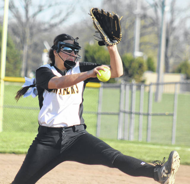 Olivia Wolffe delivers the pitch for Miami Trace during a Frontier Athletic Conference game against Washington High School Friday, April 27, 2018. Wolffe struck out 10 batters in an 11-1 Miami Trace victory.