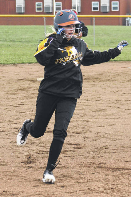 Shayln Landrum pulls into third base for Miami Trace during a Frontier Athletic Conference game against Hillsboro Monday, April 9, 2018 at Miami Trace High School.
