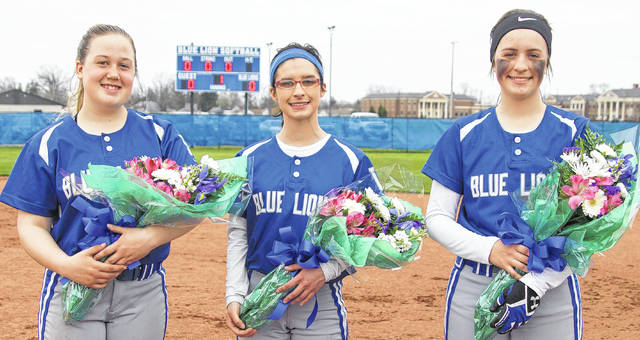 The Lady Lions honored their three seniors prior to Wednesday's game against Chillicothe. (l-r); Maddison Osborn, Tessa Yoakum and Annie Semler.