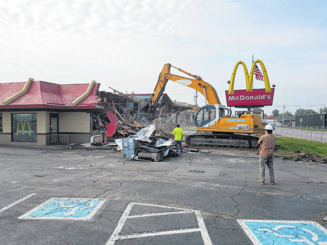 The McDonald's restaurant on South Elm Street in Washington Court House that had been in existence since 1974 was demolished on Thursday morning. A new, updated McDonald's will be built to replace it. A group of residents gathered at the fence and surrounding areas to watch the demolition.