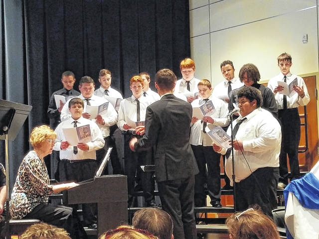 """The ceremony began with the Washington High School men's chorus performing """"Tell My Father"""" and the Washington High School vocal ensemble performing the national anthem."""