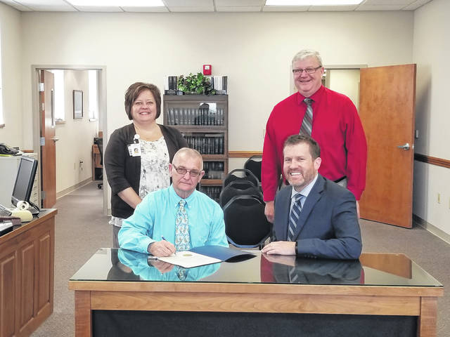 Back row: Whitney Gentry, director of marketing at FCMH, Fayette County Commissioner Dan Dean. Front row: Fayette County Commissioner Jack DeWeese, FCMH CEO Mike Diener.